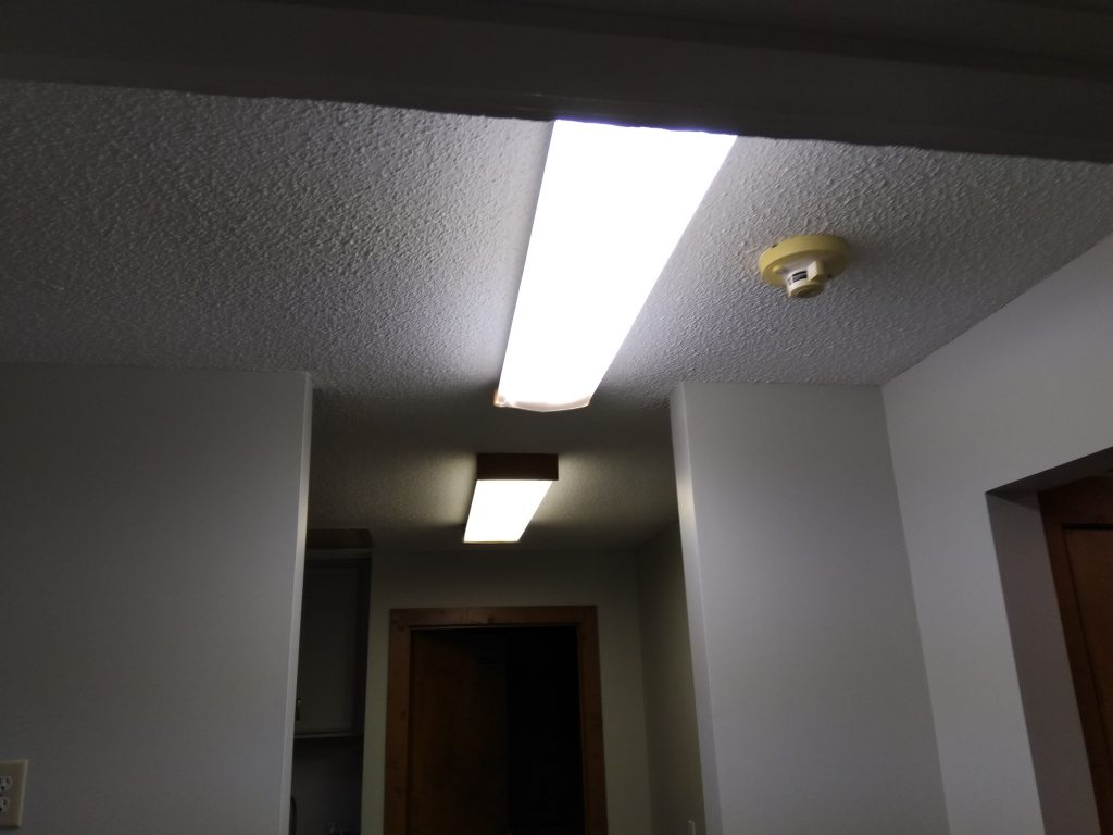 picture of hallway with old light fixtures