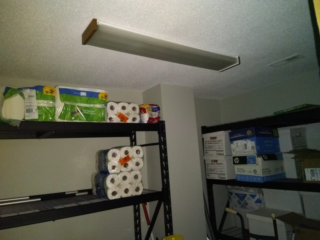 picture of supply closet with non-working light fixture